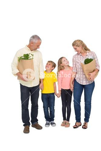 Happy family with grocery bags