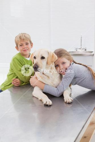 Cute labrador with its cheerful owners