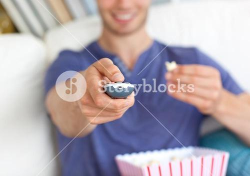 Young attrative Man holding popcorn