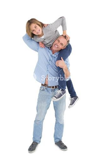 Smiling man carrying son on his shoulders