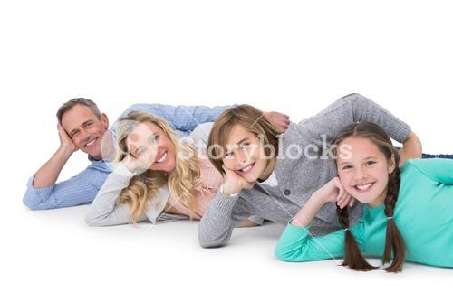 Smiling family lying on the floor in row