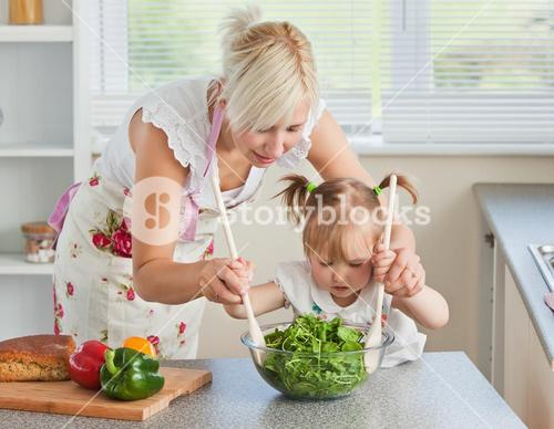 Blond mother and child cooking