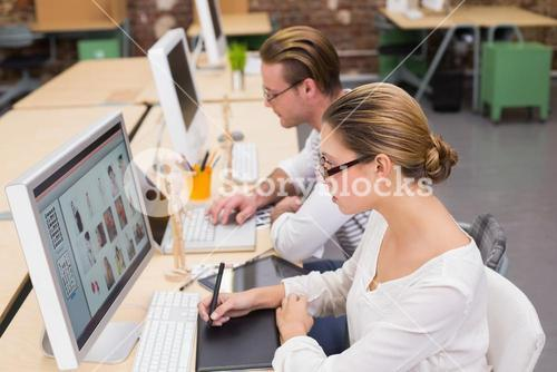 Concentrated casual photo editors using digitizer in office