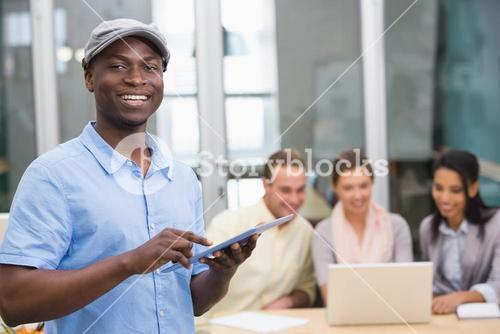 Casual businessman with colleagues in office