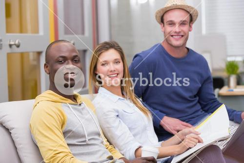 Casual business people sitting on couch