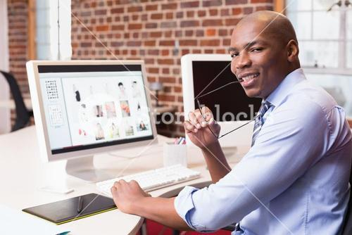 Businessman with computer at office desk