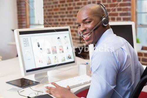 Happy businessman using computer