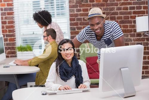 Creative business people using computer