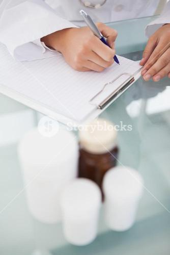 Doctor writing out prescriptions