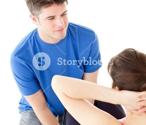 Concentrated man doing fitness exercises with a woman
