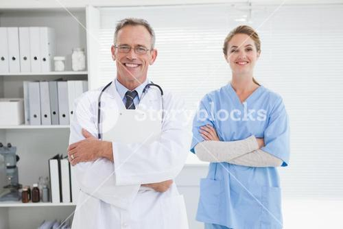 Smiling doctor with fellow co worker
