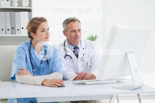 Medical workers looking at a computer