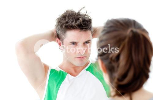 Goodlooking man doing fitness exercises with a woman