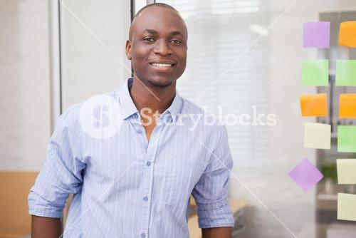 Smiling creative businessman during a meeting
