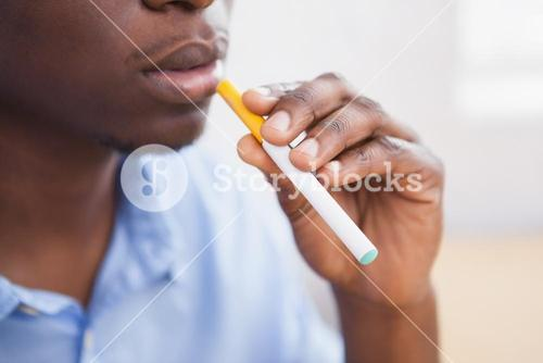 Businessman smoking an electronic cigarette