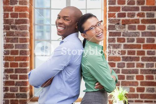 Casual business people smiling at camera