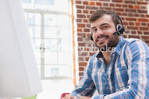 Casual businessman wearing a headset