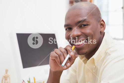 Casual businessman with electronic cigarette