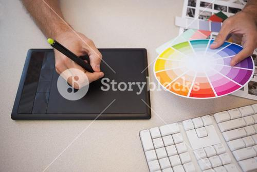 Designer using graphics tablet and colour wheel