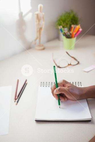 Designer sketching on paper with pencil