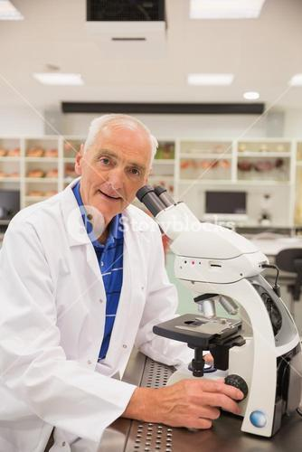 Medical professor working with microscope