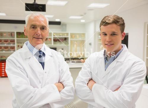 Science student and lecturer smiling at camera