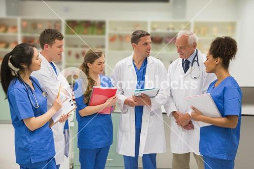 Medical professor talking with students