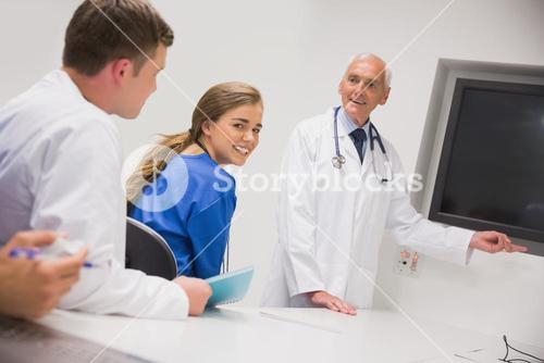 Medical professor teaching young students