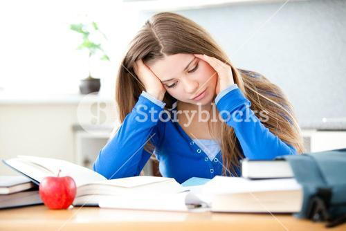 Young girl studing in living room