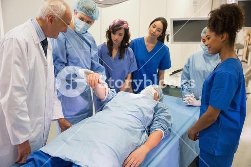 Medical students learning from professor