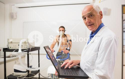Doctor conducting fitness test smiling at camera