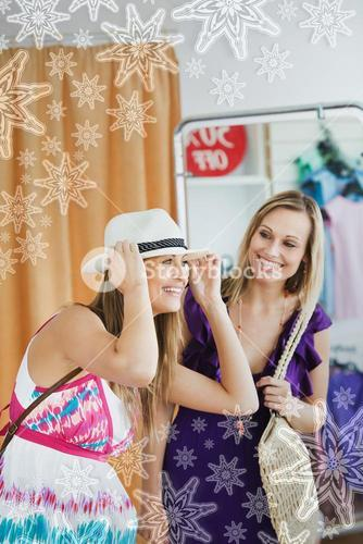 Smiling women choosing clothes together