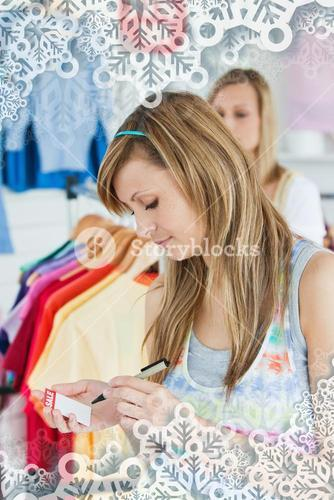 Happy women choosing clothes together