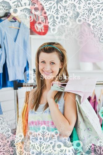 Smiling woman choosing her clothes