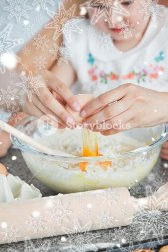Mother and small child baking cookies