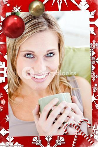 Positive blond woman holding a cup smiling at the camera