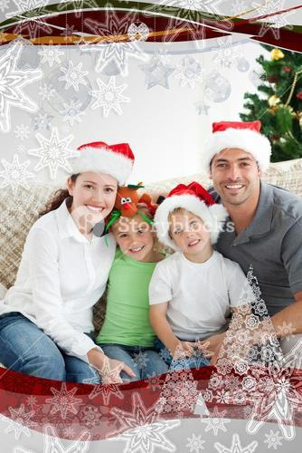 Adorable family at christmas sitting in the livingroom