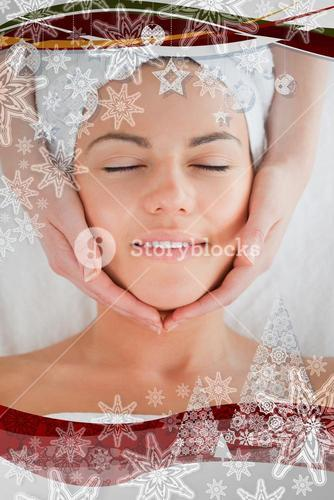 Smiling woman having a facial massage