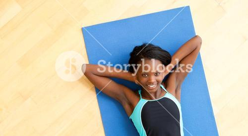 Smiling woman doing fitness