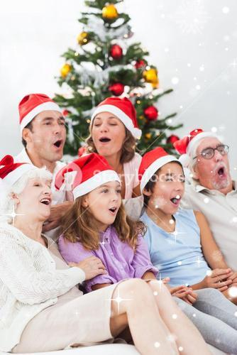 Extended family singing christmas carols