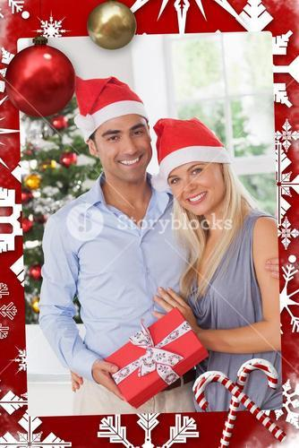 Composite image of attractive couple at christmas