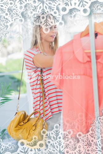 Woman standing and looking at clothes