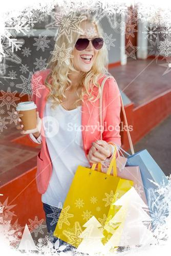 Pretty blonde holding shopping bags and coffee cup