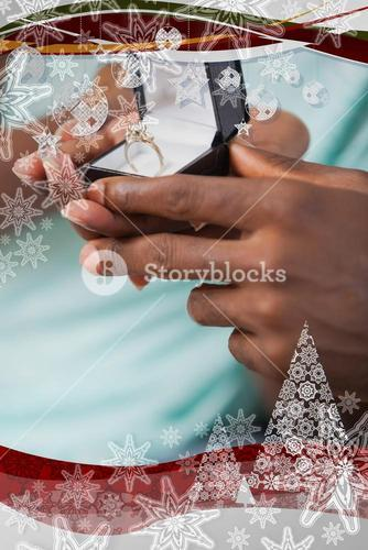 Man holding engagement ring in box