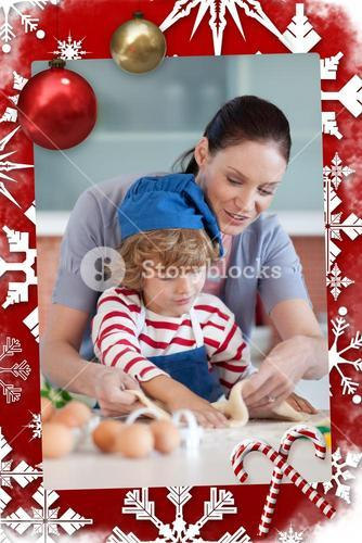 Radiant mother and her son baking at home