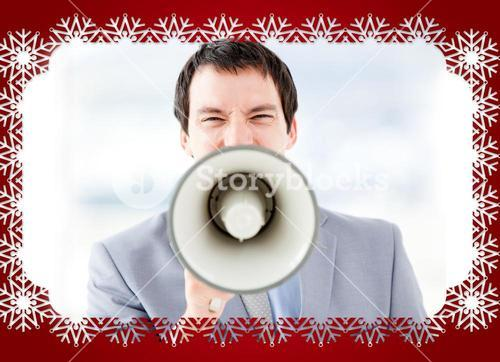 Portrait of an stressed businessman using a megaphone