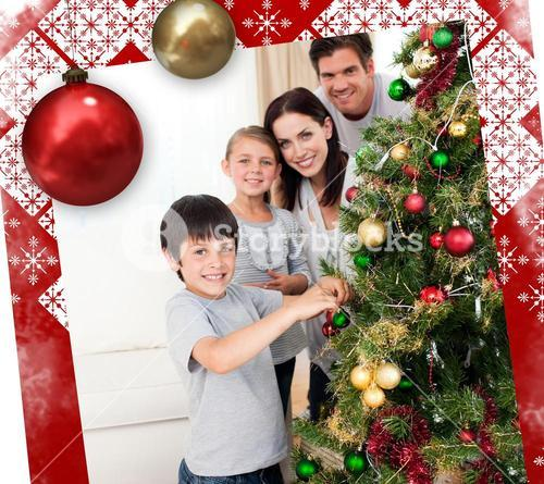 Smiling family decorating a christmas tree