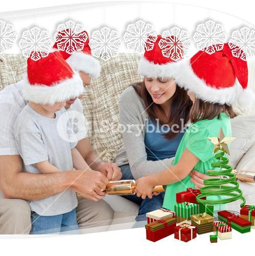 Family opening crackers together on the sofa
