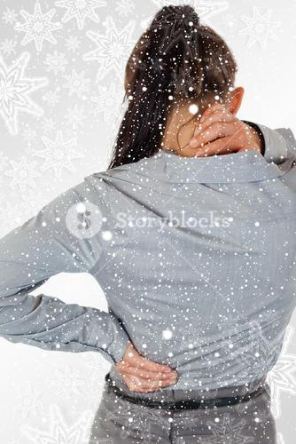 Portrait of the painful back of a young businesswoman
