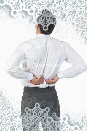 Portrait of the painful back of a young businessman